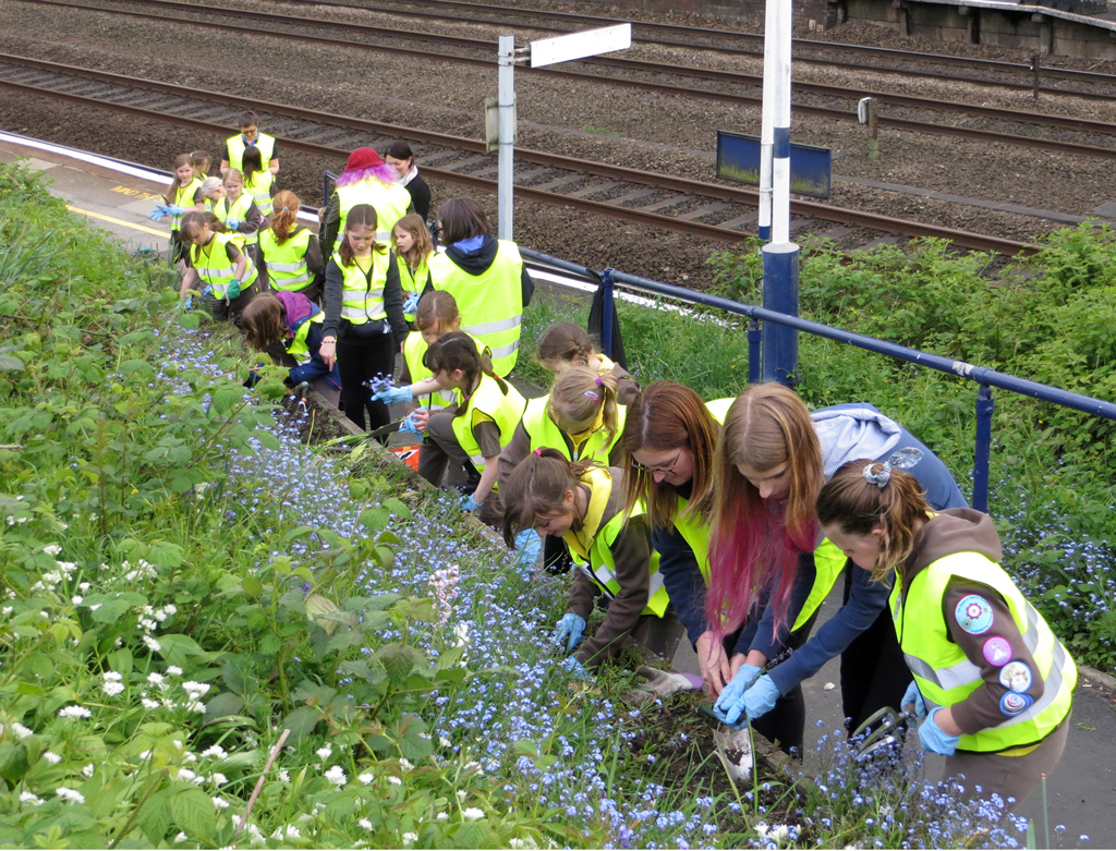 a) 3rd Heaton Chapel Brownies helping the Friends of Heaton Chapel Station