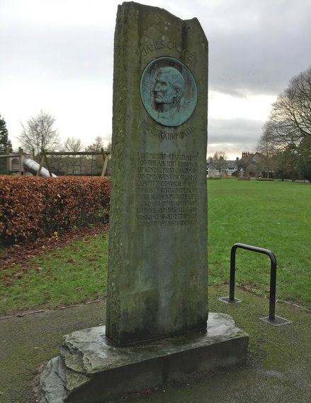 2. Simple standing stone monument with text and bronze plaque