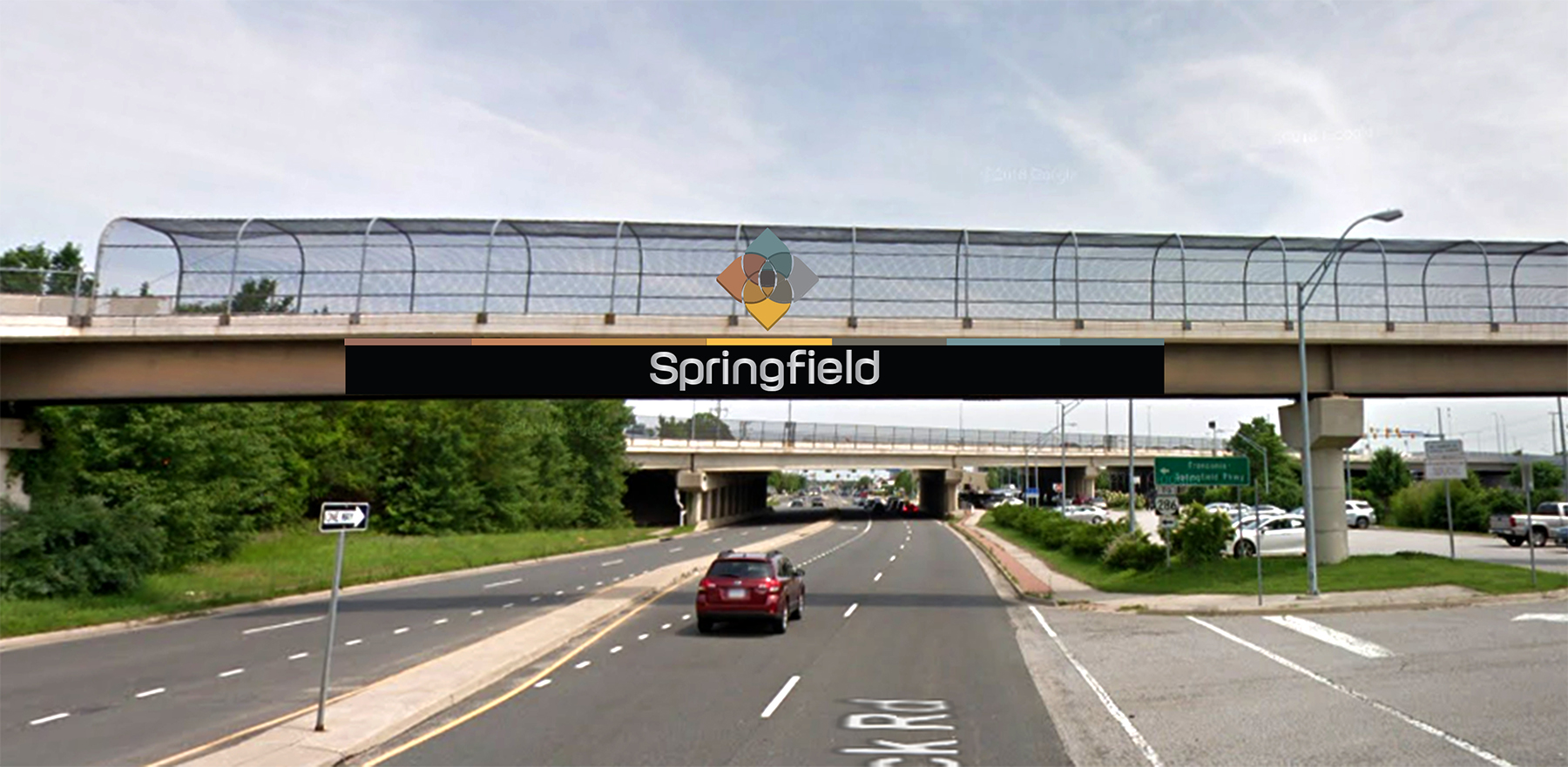 This overpass design is an example of the logo on the metal railing, color banding, and stainless steel text to pop on the black background.