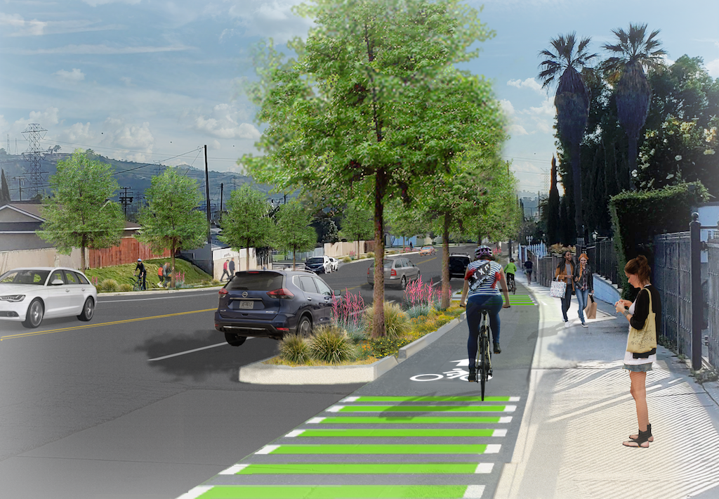 D) One-way separated bike lanes with landscape areas on both sides of the street