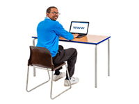 A man sitting in at a computer