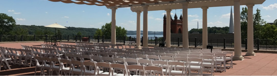The Johnson Terrace, the library's outdoor rooftop area, set with chairs for an event.
