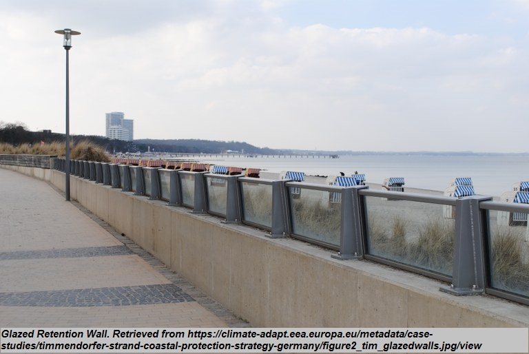 """Glazed Retention Wall<br><span style=""""font-family: arial, helvetica, sans-serif; font-size: 12pt; color: #4a4a4a;"""">Permanent flood protection measure constructed to prevent water intrusion. Glazed section is added to traditional concrete retention section to soften views and provide esthetic value. The glazed material can be constructed to offer different height ratios and levels of protection.</span>"""
